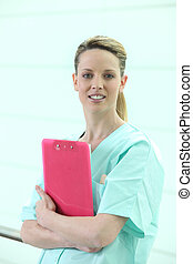 Nurse holding clip-board
