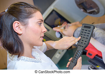 Nurse holding remote controller for xray machine