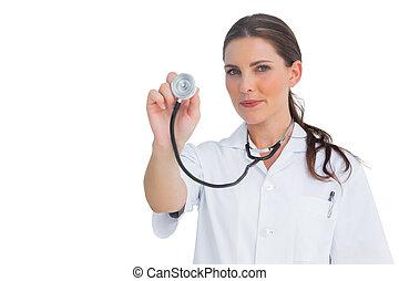 Nurse holding up her stethoscope
