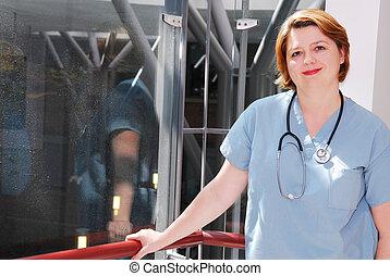 Nurse in a hospital - Portrait of a smiling nurse in a...
