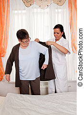 Nurse in aged care for the elderly in nursing homes