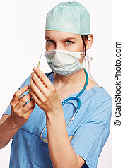 Nurse in blue dress with Op stethoscope and syringe as Cut