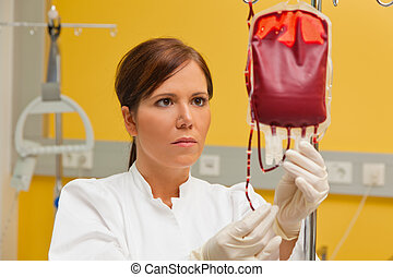nurse in hospital with blood products.