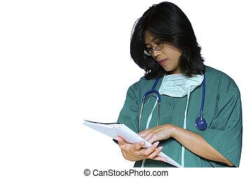 Nurse in scrubs checking