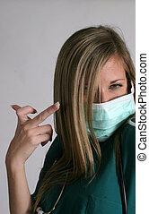 Nurse in surgical mask shooting a bird