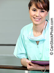 Nurse leaning against railing