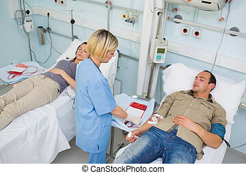 Nurse looking after a transfused patient