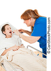 Little boy in the hospital opening his mouth so a nurse can examine his throat. Isolated on white.