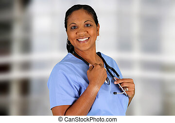 Nurse - Minority nurse working at her job in a hospital