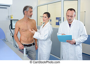 Nurse next to bare chested man