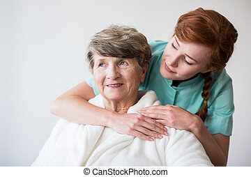 Photo of nurse and senior female patient on geriatric ward