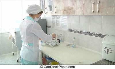 Nurse preparing intravenous, two shots