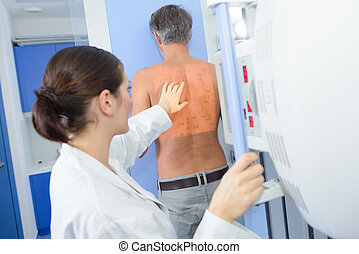 Nurse preparing patient for scan