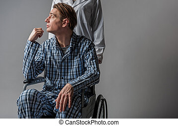 Nurse pushing tranquil cripple in wheelchair