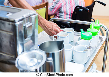 Nurse serving food in nursing home