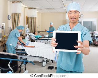 Nurse Showing Digital Tablet In Ward