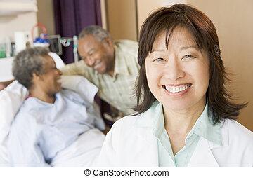 Nurse Smiling In Hospital Room