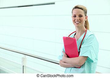 Nurse standing in corridor