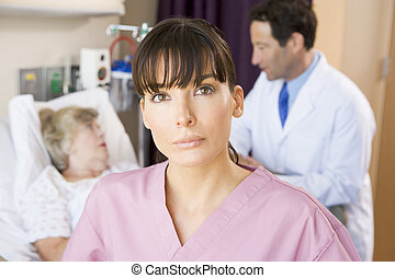 Nurse Standing In Hospital Room,Doctor Talking To Patient
