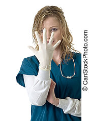 Nurse staring at latex glove on hand in front of face