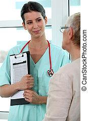 Nurse talking to an older woman