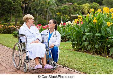 nurse talking to patient outdoors
