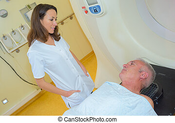 Nurse talking to patient waiting to have scan