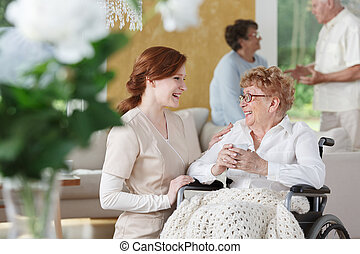 Nurse talking to senior