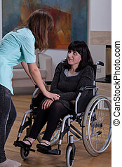 Nurse talking with disabled woman