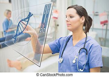 Nurse touching screen showing blue DNA helix data in...