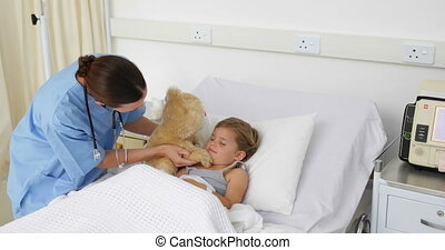 Nurse trying to cheer up a sick girl