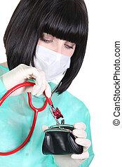 Nurse using stethoscope on purse