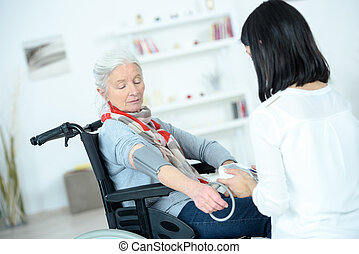nurse visiting patient in home