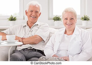 Nurse visiting senior man