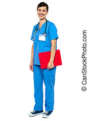 Nurse wearing blue uniform and holding red clipboard