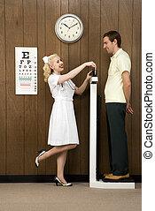 Nurse weighing man.