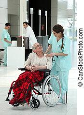 Nurse with an elderly lady in a wheelchair
