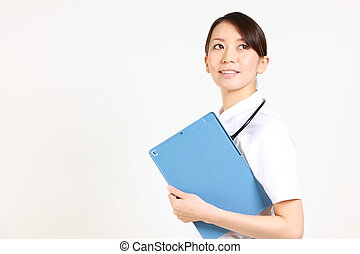nurse with clinical record%u3000 - studio shot of Japanese...