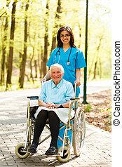 Nurse with elderly Lady in Wheelchair
