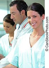 Nurse with her medical team