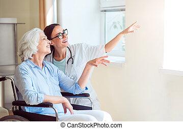 Nurse with her patient in wheelchair