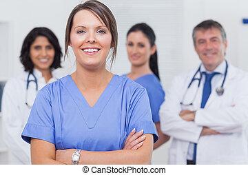Nurse with her team
