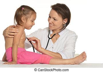Nurse works with kid