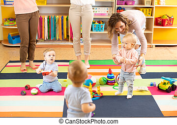 kids or children playing in kindergarten room