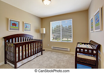 Nursery room in soft beige color with window