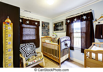 Nursery room interior with crib and rocking chair