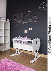 Nursery room with chalkboard wall - White nursery room with...