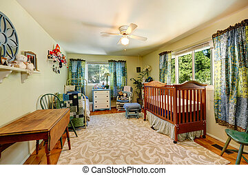 Nursery room with crib and old bed