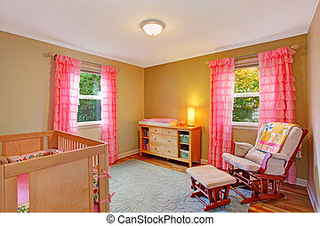 Nursery room with pink ruffle curtains