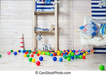 Nursery with colorful toys and balls. Nobody playing.
